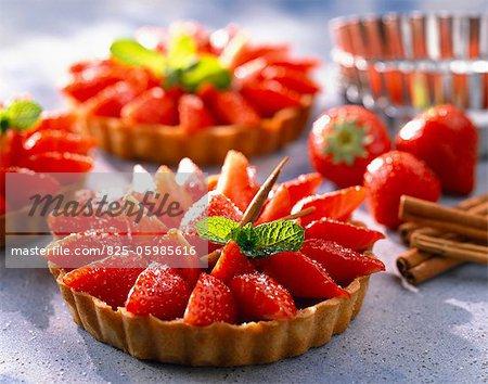 individual strawberry tarts with raspberry cream