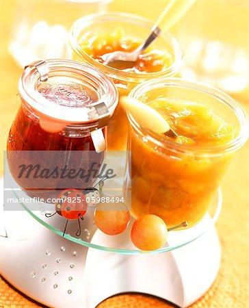 Pots of plum and raspberry jams