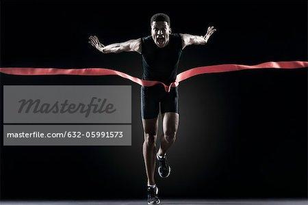Runner crossing finishing line