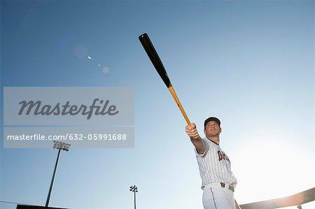 Baseball player holding out baseball bat