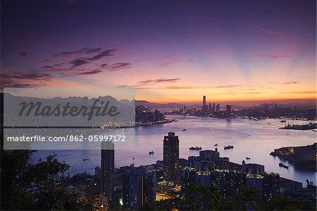 Hong Kong Island and Kowloon skylines at sunset, Hong Kong, China
