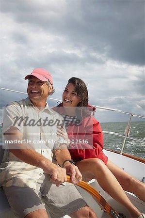 Mature couple sailing