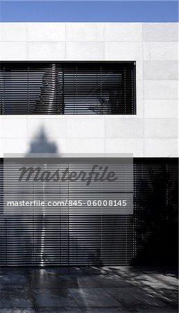 Black shuttered exterior of UP House, Hertzelia, Tel Aviv District, Israel. Architects: Pitsou Kedem