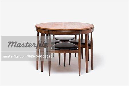 Teak Extending Table and Tripod Chairs Dining Set, Danish, manufactured by Frem Rojle. Designer: Hans Olsen