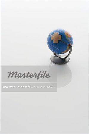 Globe With Bandaid