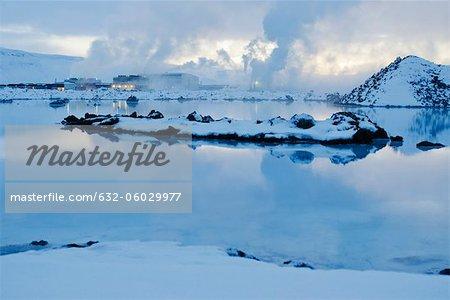 Iceland, Reykjanes Peninsula, Blue Lagoon geothermal spa, geothermal power plant in background