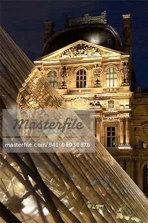 Louvre reflections in glass pyramid at twilight, Rue de Rivoli, Paris, France, Europe