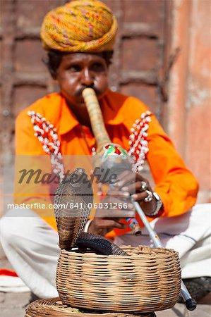 Cobra snake charmer outside the City Palace, Jaipur, Rajasthan, India, Asia