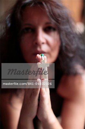 Woman praying the rosary, Cotonou, Benin, West Africa, Africa