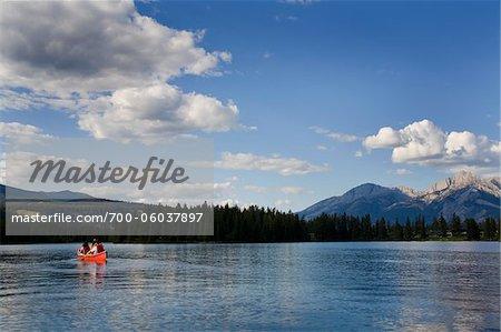 People in Canoe on Lac Beauvert, Jasper National Park, Alberta, Canada
