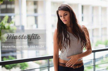 Upset woman standing on balcony