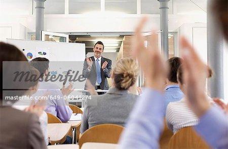 Business people applauding at seminar