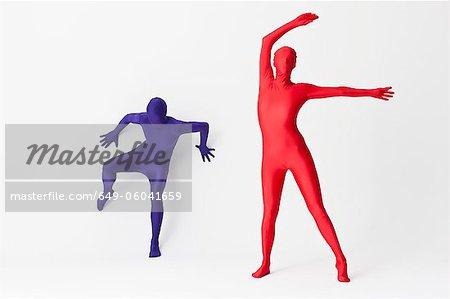 Couple in bodysuits dancing