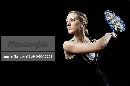 Tennis player holding racket