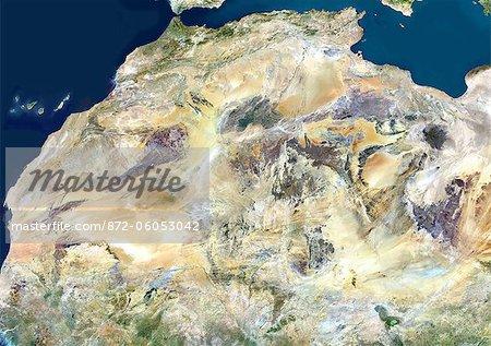 Désert du Sahara, Afrique, vraie couleur Image-Satellite. Désert du Sahara, image satellite couleur vraie. Le Sahara est le plus grand désert chaud du monde, fait de montagnes volcaniques et de sables. Image composite à l'aide de données provenant des satellites LANDSAT 5 & 7.