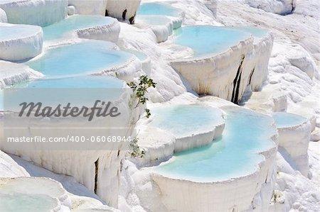 Blue cyan water travertine pools at ancient Hierapolis, now Pamukkale, Turkey