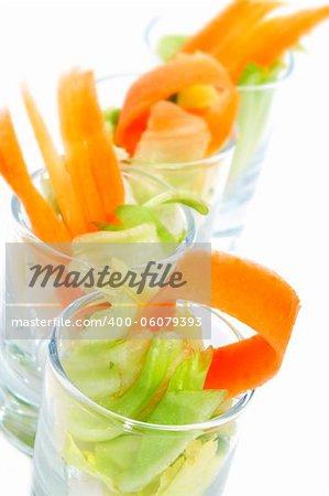 closeup of some shot glasses of salad