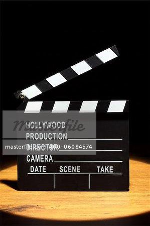 Movie clapper board under the spotlight