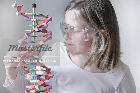 Girl examining molecular model