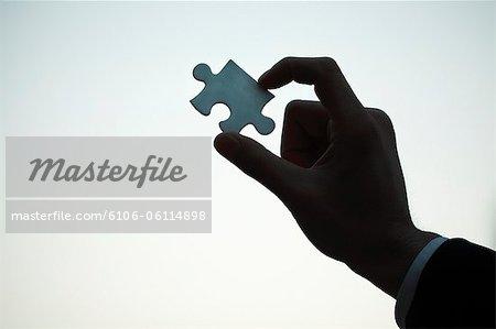 Mann mit Puzzle