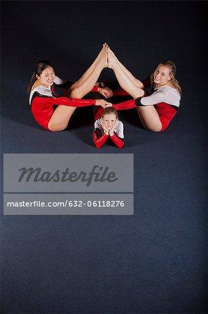 Female gymnasts performing floor routine