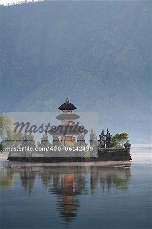 misty dawn at Pura Ulun Danu hindu temple in the crater lake of bratan volcano in bedugal bali