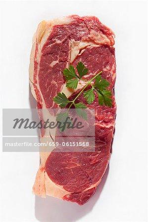A raw ribeye steak