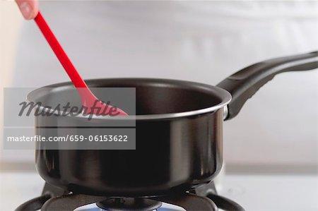 A saucepan on a gas stove