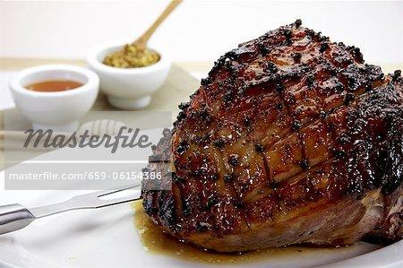 Glazed roast ham pierced with cloves