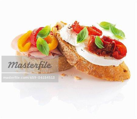 Slices of ciabatta bread with ham, pepper, mozzarella and tomatoes