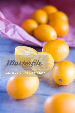 Several kumquats, whole and halved