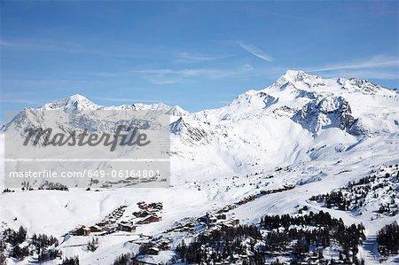 Trees and ski slopes on snowy mountains