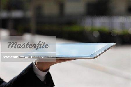 homme d'affaires avec le tablet PC, gros plan des mains