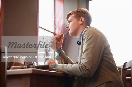 Man eating croissant
