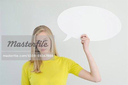 Serious woman holding a speech bubble