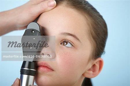 Girl having eye test