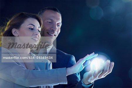 Businesspeople holding light