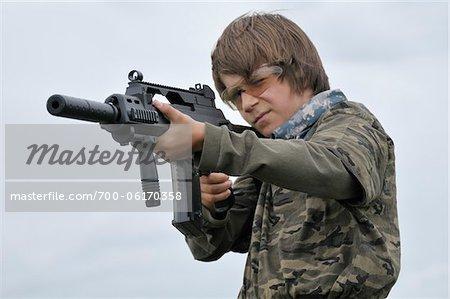 Boy Aiming Gun