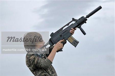Boy Aiming Gun into the Air