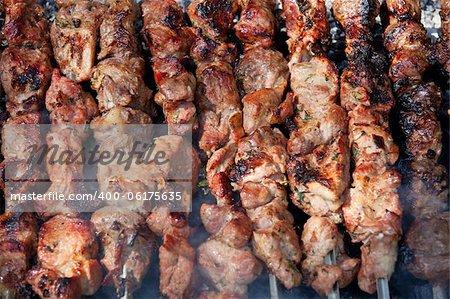 Background of grilled shish kebabs on skewers