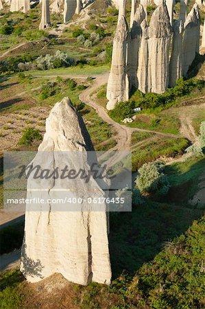 Failry Chimneys in Cappadocia, Turkey on dramatic sky background