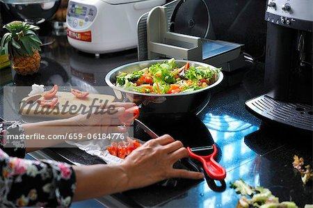Salad being prepared