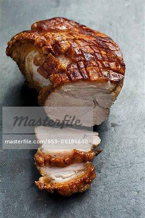 Roast pork with crackling, partly carved
