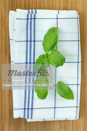 Basil leaves on a tea towel