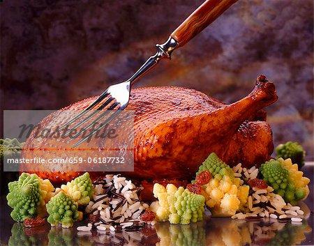 Rôti de canard sur romanesco et riz sauvage
