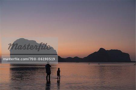 People on Beach at Sunset, Pak Meng Beach, Trang, Thailand