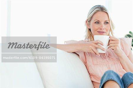 Blonde smiling on a divan