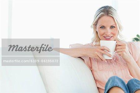 Portrait of a blonde on a divan