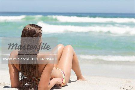 Woman sunbathing on the sand