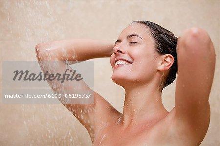 Smiling woman enjoying a shower